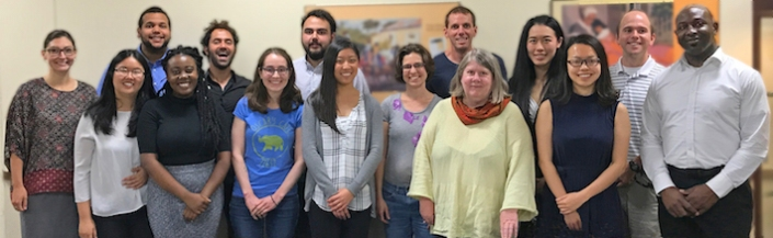 Program directors, Mia Riza and David Haynes, flank the group of 2017 summer program fellows and mentors.